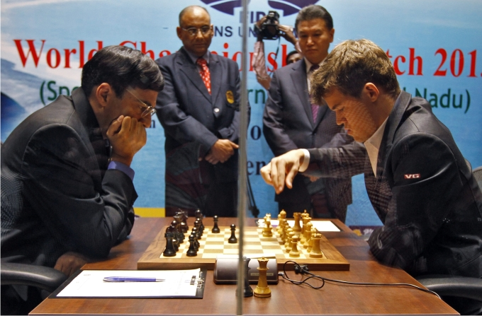 Magnus Carlsen  makes a move against India's Viswanathan Anand during the FIDE World Chess Championship in the southern Indian city of Chennai November 9, 2013. REUTERSBabu