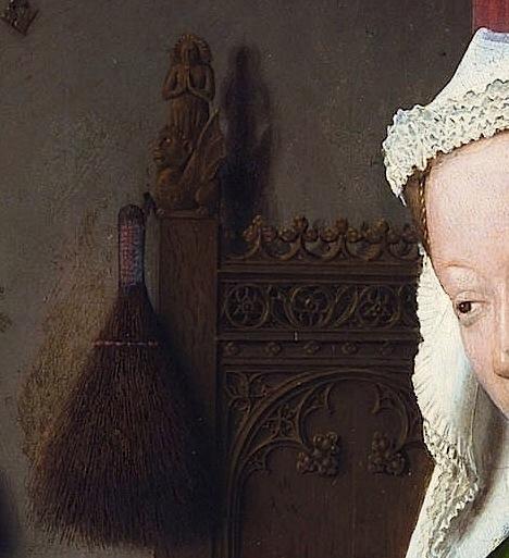 Detalle del retrato del matrimonio Arnolfini. Talla de Santa Margarita de Antioquia en el cabecero de la cama, con el dragón a sus pies.
