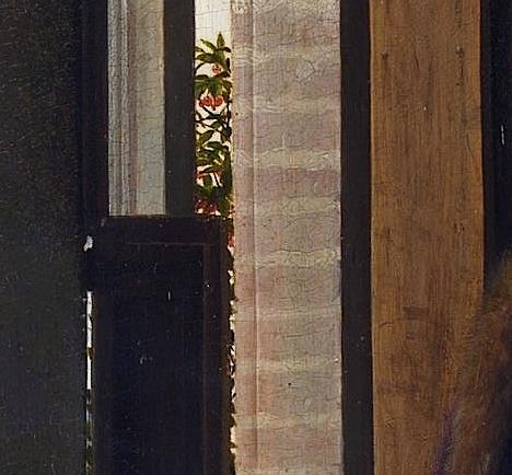 Detalle de las cerezas tras la ventana.