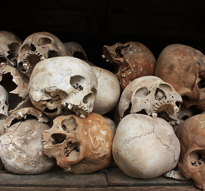 Skulls of the victims of the Khmer Rouge occupation of Cambodia in the memorial stupa at the Choeung Ek Killing Field Phnom Penh Cambodia istolethetv CC