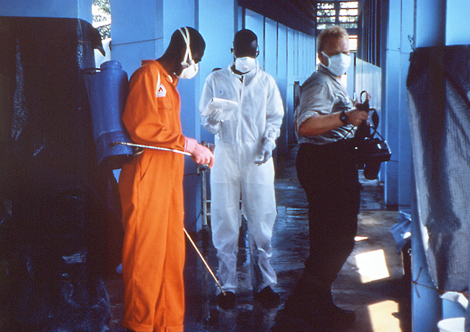 This 1995 photograph shows sanitary procedures being practiced in a clinic in Zaire during Ebola virus disease outbreak.