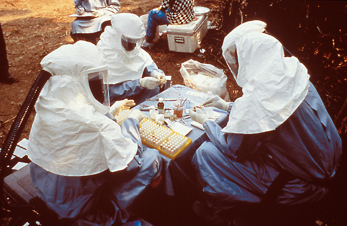 cientists wearing personal protective equipment (PPE) testing samples for the Ebola virus from animals collected in Zaire ~ 1995 -  Public Health Image Library