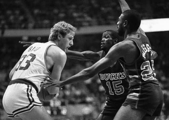 Celtics' Larry Bird is double-teamed by Milwaukee Bucks Craig Hodges (150 and Paul Pressey as Bird tries to pass ball off during 1st quarter action of the game at Boston Garden, 12/19
