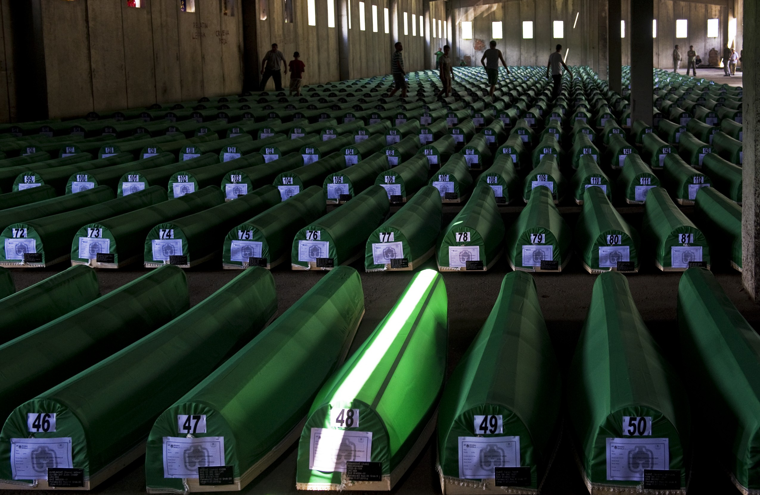 """Srebrenica genocide was the genocidal killing of more than 8000 Bosniaks, mainly men and boys around the town of Srebrenica during the Bosnian War. The killing was perpetrated by units of the Army of Republika Srpska (VRS) under the command of General Ratko Mladic. In April 1993, the United Nations declared the besieged enclave of Srebrenica a """"safe area"""" under UN protection. However, in July 1995, the United Nations Protection Force (UNPROFOR) contingent of Dutch peacekeepers did not prevent th --- Image by © Arne Hodalic/Corbis"""