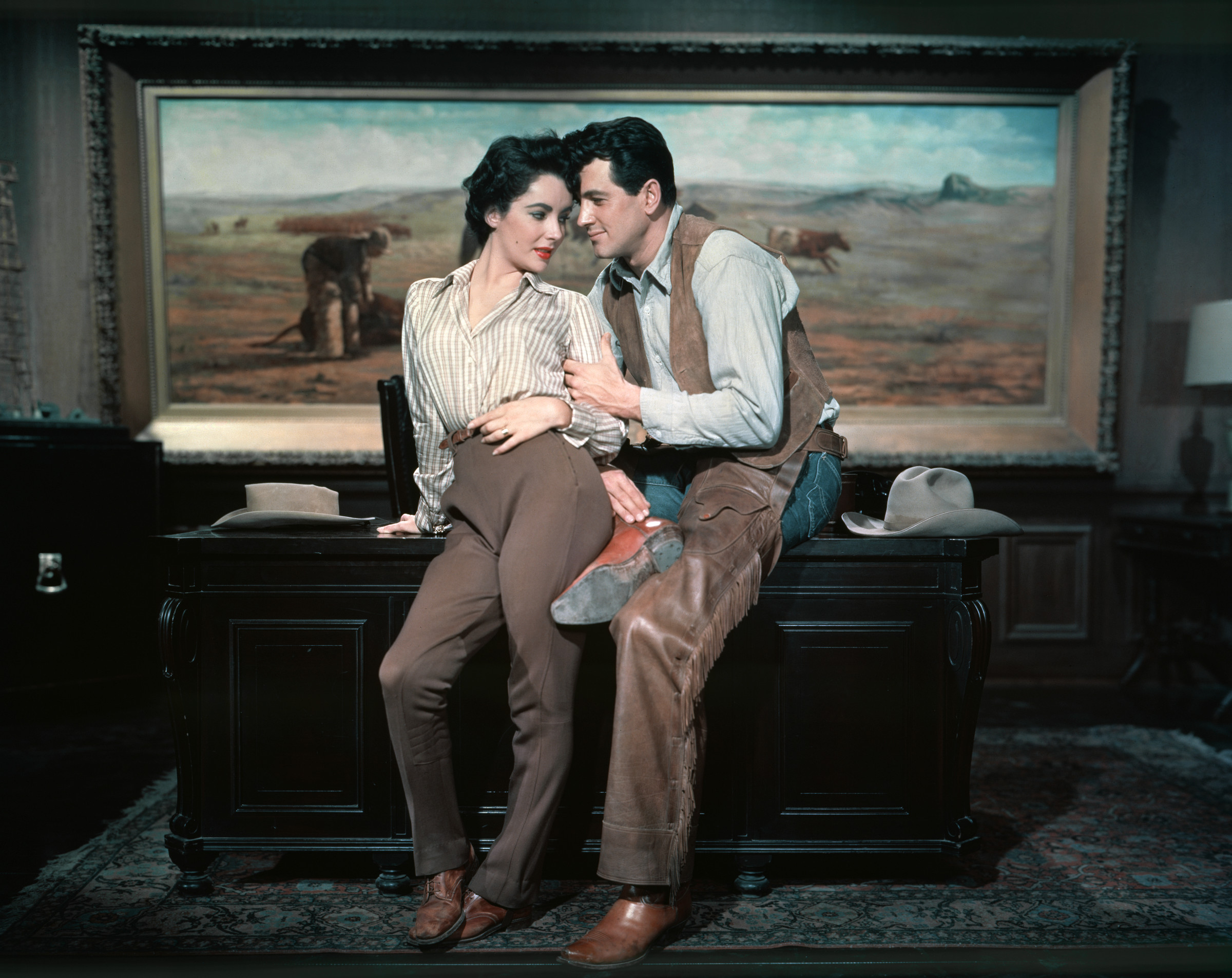 "1957 --- Elizabeth Taylor and Rock Hudson on the set of ""Giant"". --- Image by © Sunset Boulevard/Corbis"
