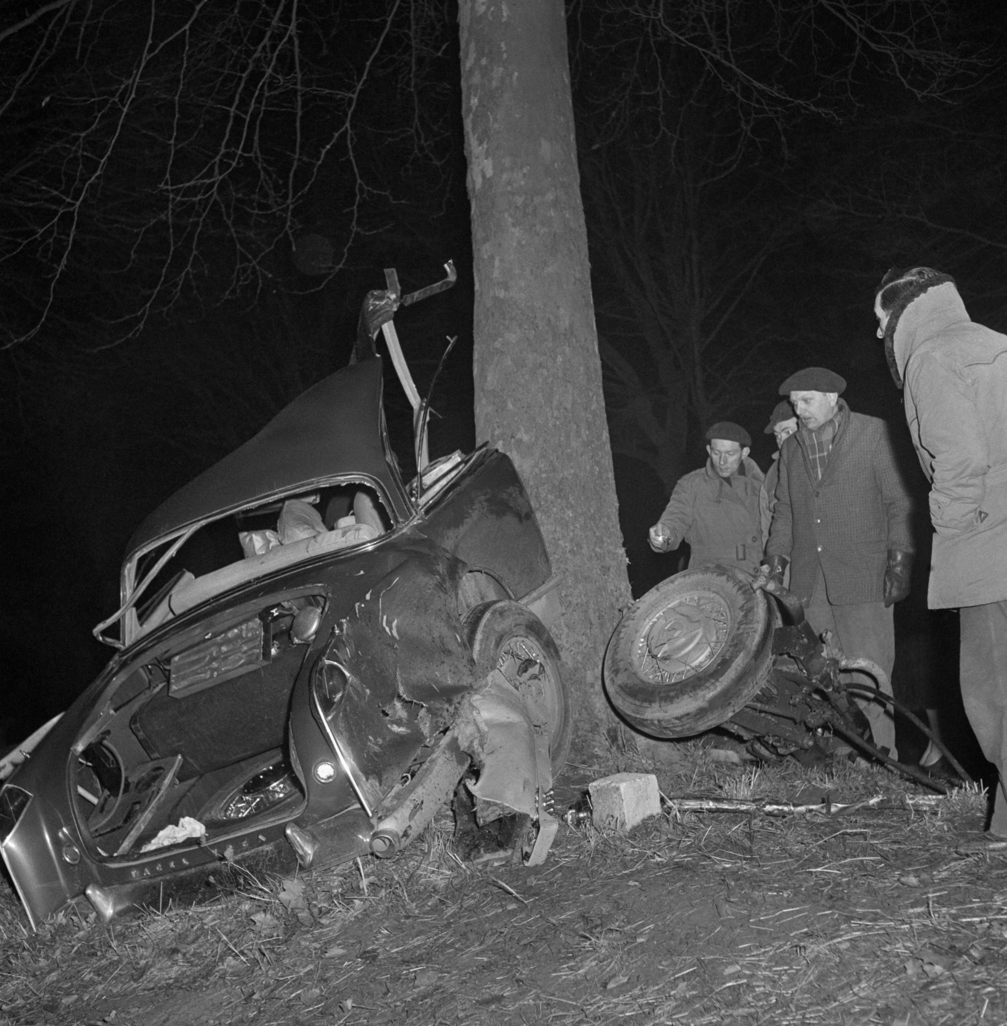 06 Jan 1960 --- Rescuers take a last look at the shattered wreck of the powerful, custom built Facel Vega auto in which famed French author Albert Camus met death near here, east of Paris. The car careened into a tree at about 80 miles an hour after tire blew out. Riding with the Nobel Literature prize winner (1957) were well-known publisher Michel Gallimard and Madame Gallimard. --- Image by © Bettmann/Corbis
