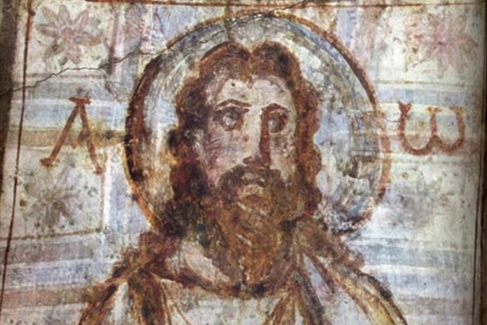 Jesús con barba y cabello largo, en unas catacumbas. Siglos IV-V.