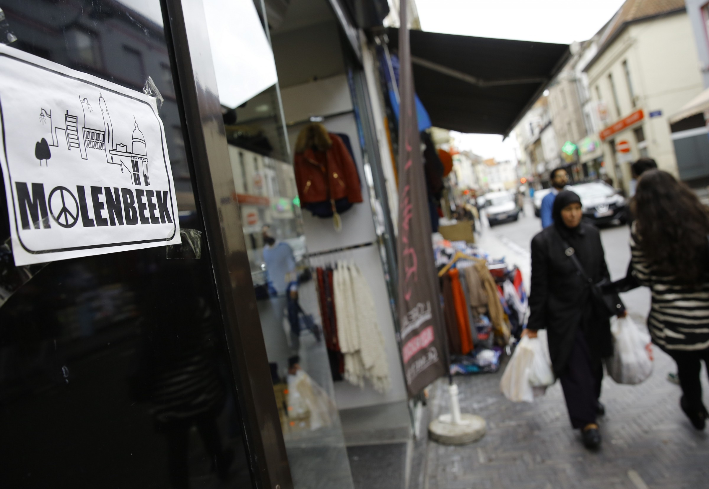 18 Nov 2015, Brussels, Belgium --- (151117) -- BRUSSELS, Nov. 17, 2015 (Xinhua) -- Pedestrians walk in a shopping street in Molenbeek district of Brussels, capital of Belgium, Nov. 17, 2015. Some Paris terror attackers are believed to live in Molenbeek neighborhood and Belgian police have launched series of raids and operations here since the last weekend. (Xinhua/Ye Pingfan) --- Image by © Ye Pingfan/Xinhua Press/Corbis