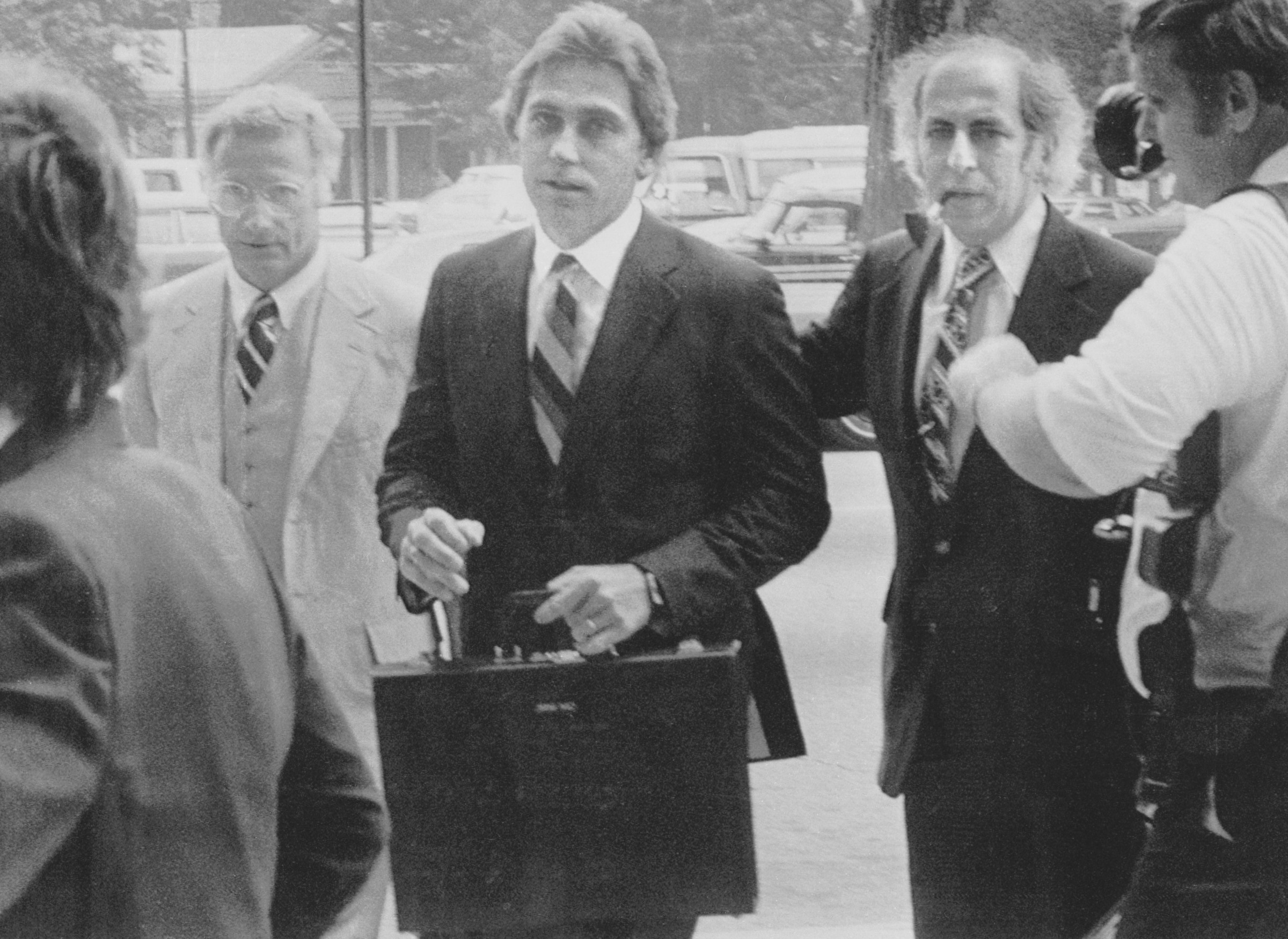 16 Jul 1979, Raleigh, North Carolina, USA --- Original caption: July 16, 1979 - Raleigh, North Carolina: Dr. Jeffrey MacDonald (center), nine and a half years after his pregnant wife and two young daughters were killed in a Fort Bragg, North Carolina apartment, entered the Federal Courthouse to stand trial for their deaths. With him are attorneys Wade Smith (left) and Bernard Segal (right). The former Army doctor told newsmen he believes he will be found innocent. The trial was expected to last six to eight weeks. --- Image by © Bettmann/CORBIS