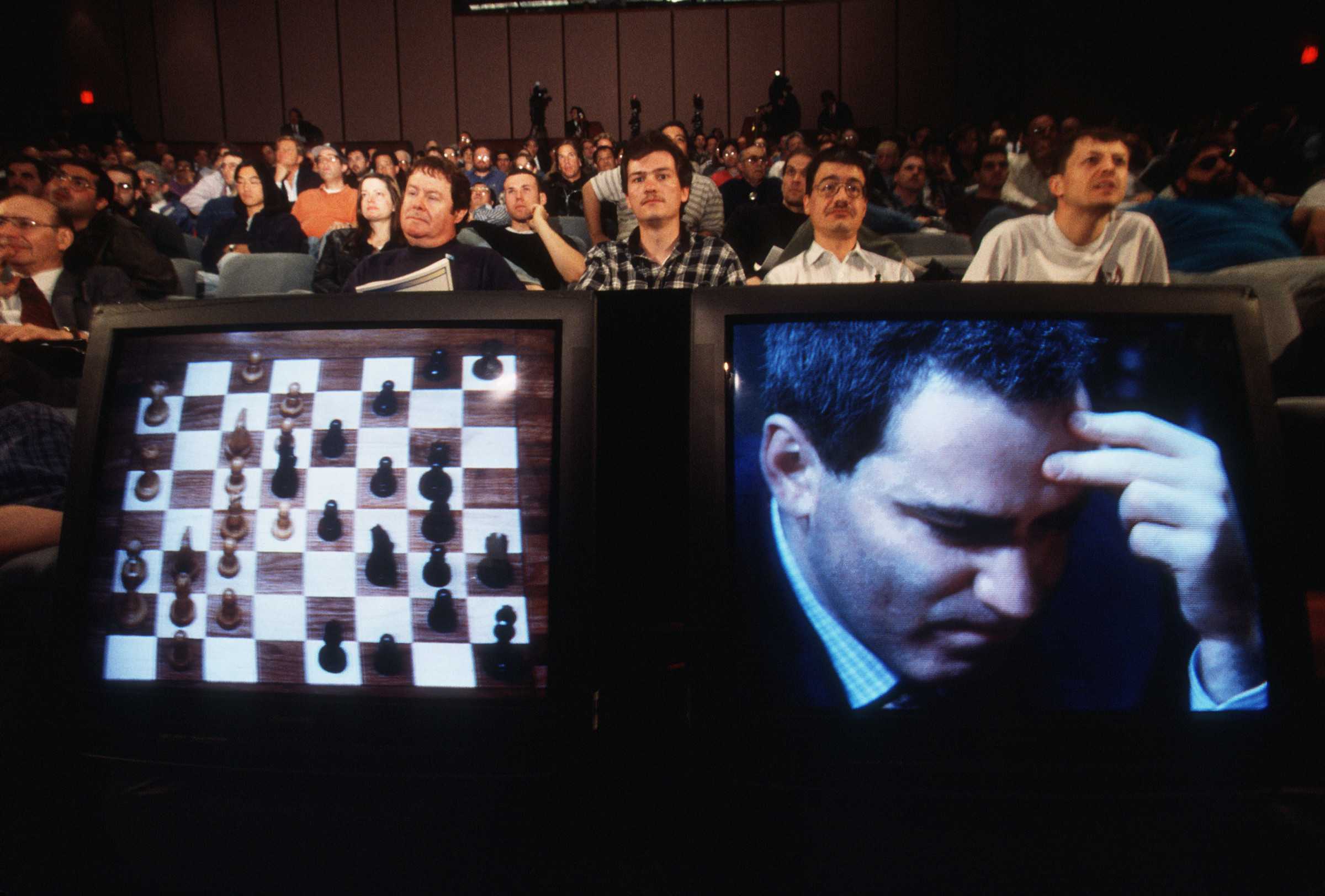 05 May 1997 --- Champion chess player Garry Kasparov plays against IBM's chess-playing supercomputer. Here, the match is watched in an auditorium via television. --- Image by © Najlah Feanny/CORBIS SABA