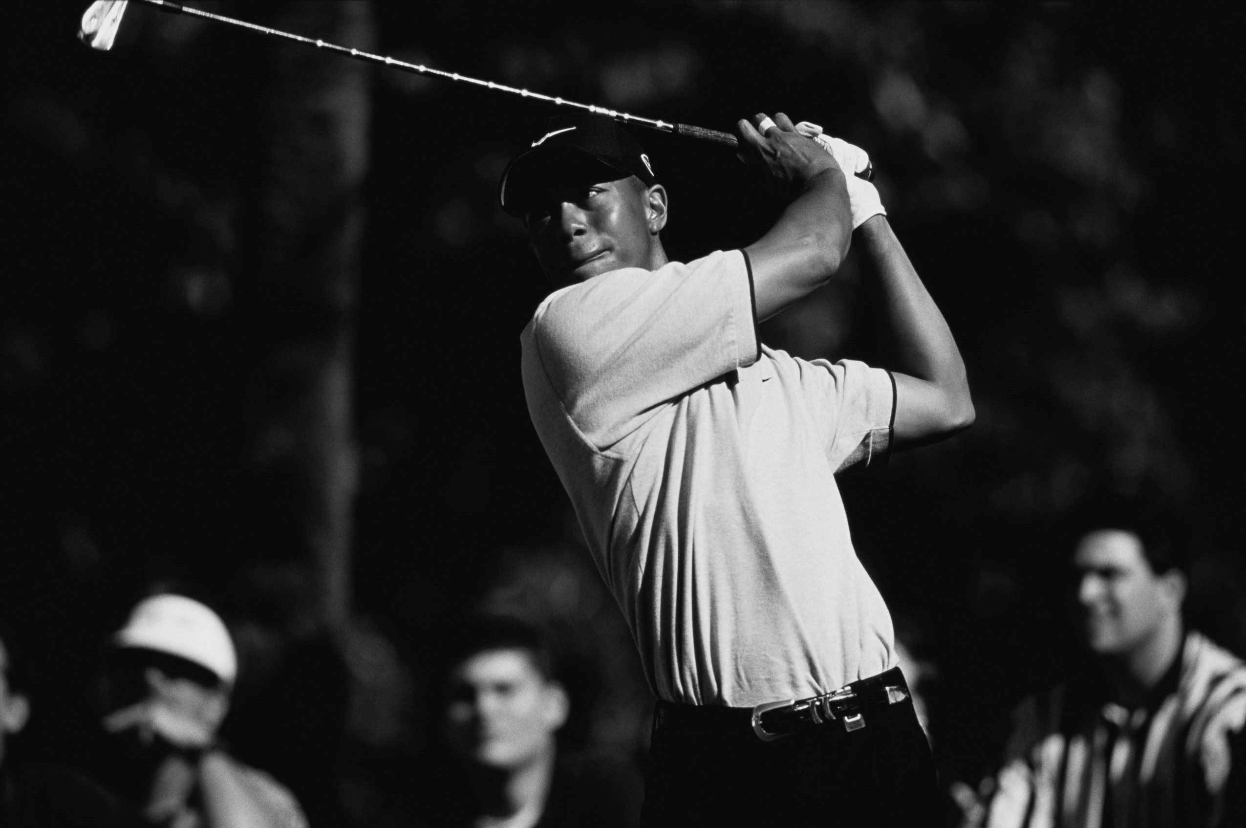 1998, Miami, Florida, USA --- Professional golfer Tiger Woods swings his golf club during the 1998 Doral Open. --- Image by © Duomo/CORBIS