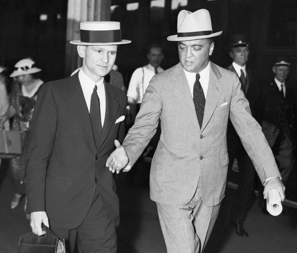 25 Jul 1934, Washington, DC, USA --- Original caption: July 1934 Washington, DC: J. Edgar Hoover, Chief of the Department of Justice, extends his hand in congratulation to his Chicago Bureau Chief, Melvin Purvis, when the latter arrived in Washington, 7/25, to give his report on the trapping and slaying of John Dillinger. It was annouced shortly afterward that Purvis and Samuel Crowly were rewarded with promotions and salary incresases for their excellent work on America's Public Enemy #1. --- Image by © Bettmann/CORBIS