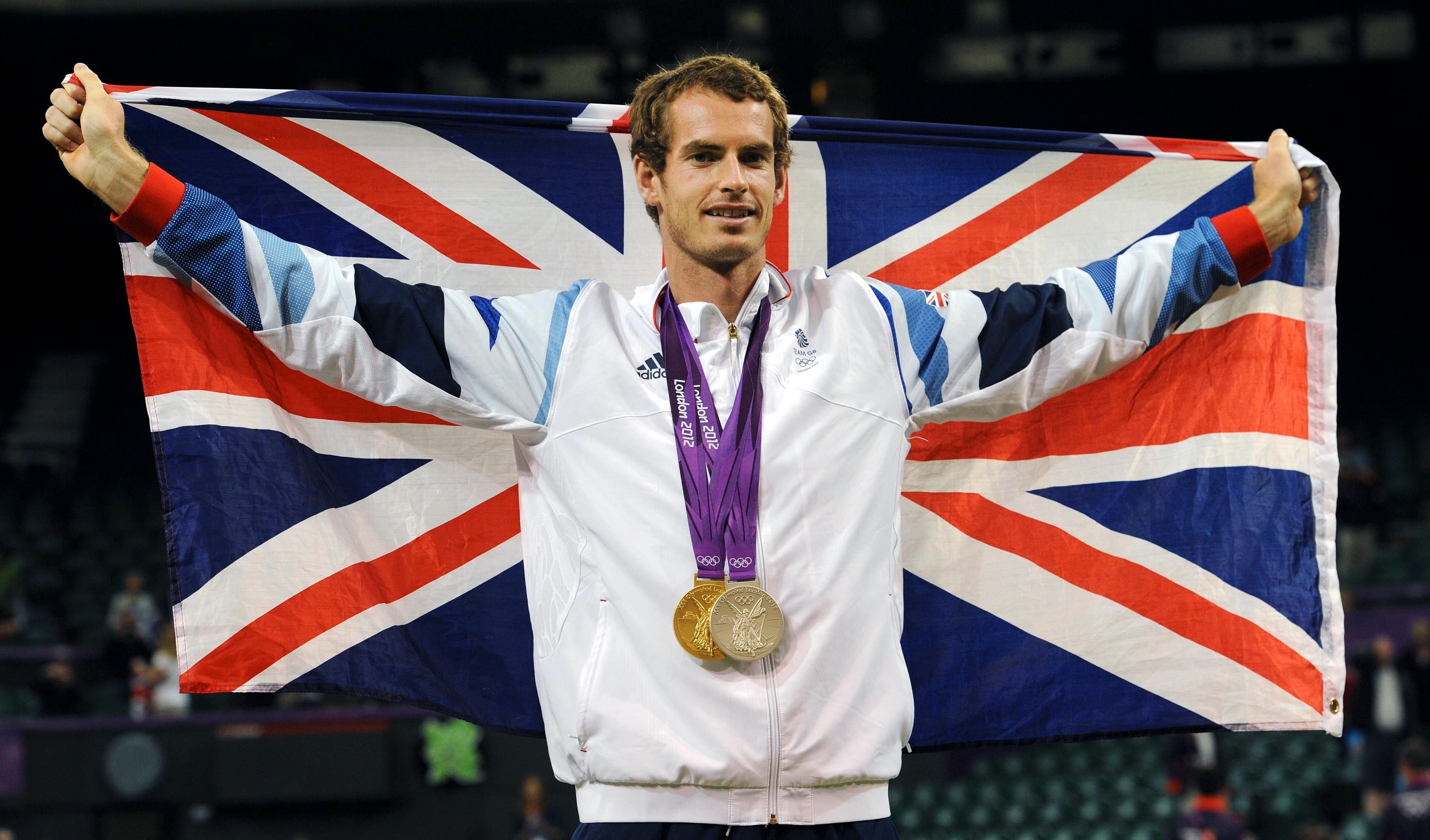File photo dated 05/08/2012 of Great Britain's Andy Murray with his Olympic Gold and Silver Medals at Wimbledon.