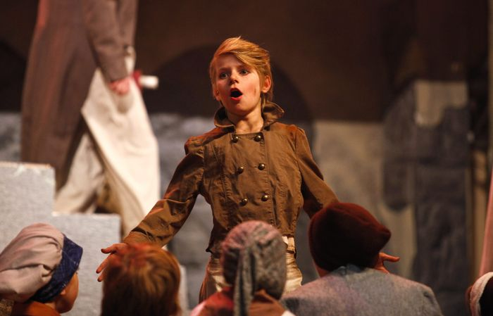 Image #: 28188508 Neil Barris | Mlive.com Jamie Miller, who plays Gavroche, acts out a scene during a dress rehearsal of 'Les Miserables' at the Midland Center for the Arts, Wednesday, March. 19, 2014. The play opens on Friday, March. 21, 2014. MLIVE.COM /Landov