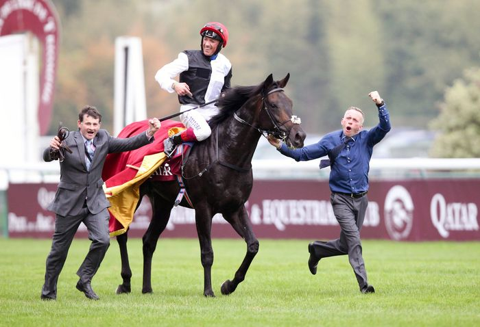 """Grand Prix de l'Arc de Triomphe"" presented by Qatar Racing . Golden Horn, mounted by jockey Lanfranco Dettori, winner 2015 - John Gosden, coach of Golden Horn - FRANCE, Paris, 04.10.2015, Horse racing, Grand Prix de l'Arc de Triomphe presented by Qatar Horse riding event, competition held on the Hippodrome de Longchamp on October 4th. race course Longchamp. Frankie Dettori;John Gosden (British racehorse trainer)"