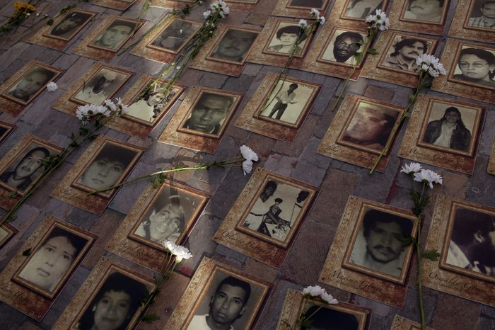 Several portraits lie on the street to commemorate the disappeared during the peace signature between the Colombian government and the Revolutionary Armed Forces of Colombia, FARC guerrillas yesterday in Bolivar's plaza. Bogota, September 26, 2016. After four years of negotiations in Havana, Cuba, both the the government of Colombia and FARC rebels agreed to peace, ending a 52 year old war that left at least 300,000 dead and 5 million people displaced. *** Local Caption *** 14876616