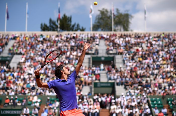 Roger Federer in action during his Second round men's singles match against Marcel Granollers on day four of the French Open at Roland Garros on May 27, 2015 in Paris, France