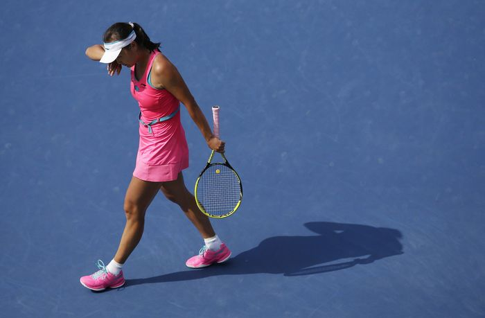 Image #: 31758194 Shuai Peng from China wipes her head in the first set of her match against Caroline Wozniacki of Denmark in the semi-finals at the US Open Tennis Championships at the USTA Billie Jean King National Tennis Center in New York City on September 5, 2014. UPI/John Angelillo /LANDOV
