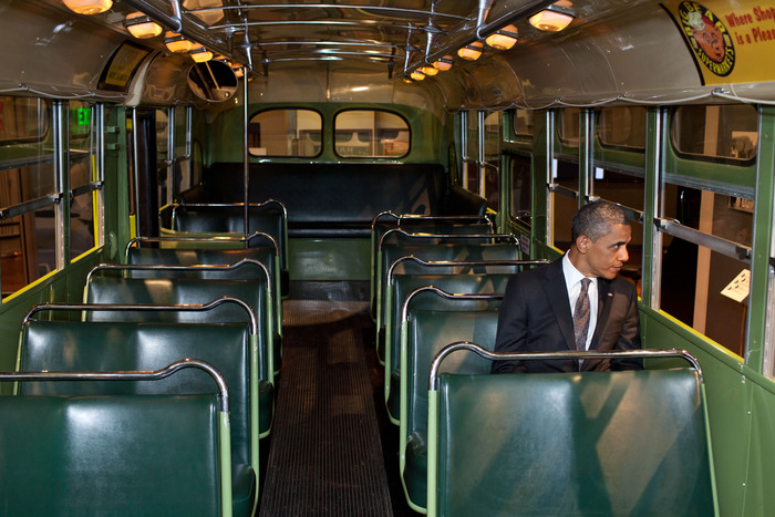 President Barack Obama sits on the famed Rosa Parks bus at the Henry Ford Museum following an event in Dearborn, Michigan, April 18, 2012. (Official White House Photo by Pete Souza) This official White House photograph is being made available only for publication by news organizations and/or for personal use printing by the subject(s) of the photograph. The photograph may not be manipulated in any way and may not be used in commercial or political materials, advertisements, emails, products, promotions that in any way suggests approval or endorsement of the President, the First Family, or the White House.Ê
