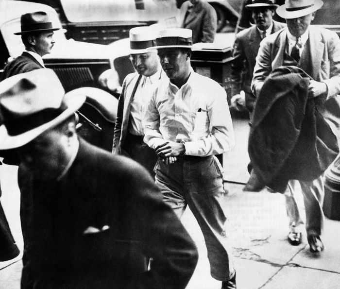 Alvin Karpis, 'Public Enemy No. 1', walks behind his captor, J. Edgar Hoover, director of the FBI, (at left) into Federal Court in St. Paul, Minn. May 03, 1936. (CSU_ALPHA_1253) CSU Archives/Everett Collection