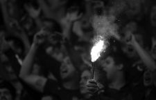 A Boca Juniors' fan holds a flare during their Argentine First Division soccer match against River Plate in Buenos Aires May 5, 2013. REUTERS/Marcos Brindicci (ARGENTINA - Tags: SPORT SOCCER)CODE: X90087