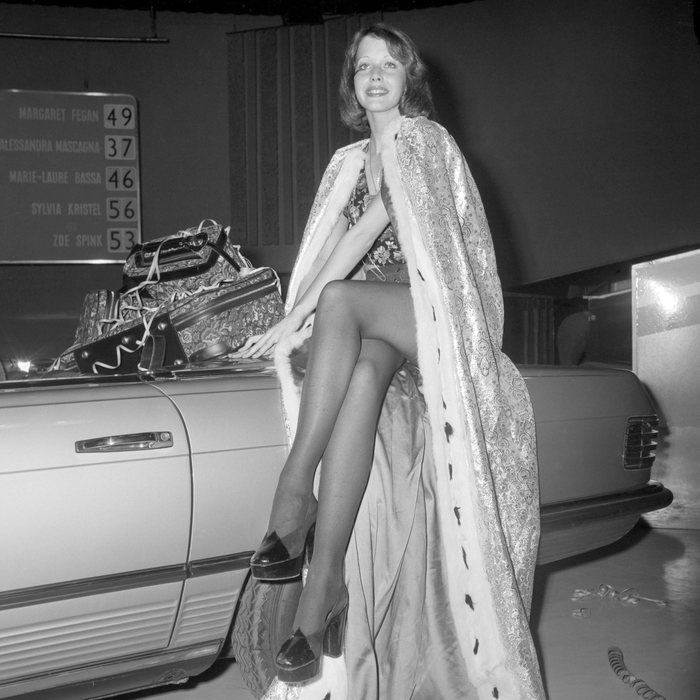 Twenty-year-old Dutch actress and model Sylvia Kristel, who was tonight crowned Miss TV Europe 1973, sits on one of her prizes - a Mercedes 350SL sports car - after her election at ATV's Elstree Studios.