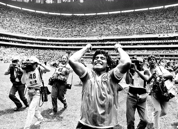 "Football - 1986 World Cup - Quarter Final - Argentina v England - Mexico City - 22/6/86 Diego Maradona celebrates Argentina's victory after his two goals, the first of which was the infamous ""Hand of God"" goal & the second one of the greatest goals of all time Mandatory Credit: Action Images / MSI PLEASE NOTE: FOR UK EDITORIAL SALES ONLY. CONTRACT CLIENTS: ADDITIONAL FEES MAY APPLY - PLEASE CONTACT YOUR ACCOUNT MANAGER"