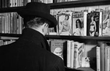 12th June 1956:  A peruser contemplates the pornography section at a Soho sex shop in London.  (Photo by John Firth/BIPs/Getty Images)