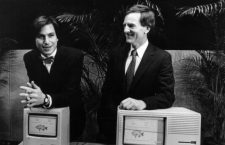 Apple Computer Chairman Steven P Jobs (left) and Apple President John Sculley prior to a shareholders ' meeting here in Cupertino , California . Jobs is standing behind a new Macintosh personal computer ; Sculley is with the Lisa II personal computer the company produces . 24 January 1984