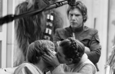 "Princess Leia (Carrie Fisher, right) kisses Luke Skywalker (Mark Hamill) while an indignant Han Solo (Harrison Ford, background) looks on. A new book, ""The Making of 'The Empire Strikes Back: The Definitive Story"" was released in October 2010.(Courtesy of Lucasfilm/MCT)"