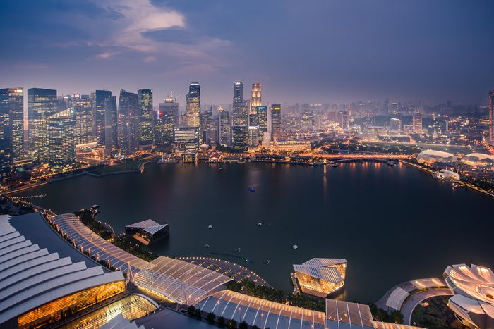 The Singapore skyline shines.