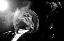 "CAPTION CORRECTION -- CORRECTING AGE Cuban musician Compay Segundo is seen in this file photo smoking a cigar while on stage in Havana, February 28, 2000. Compay Segundo died in Havana early July 14, 2003 at the age of 95 years. Born Francisco Repilado, he obtained his nickname from the slang ""compadre"" and Segundo for his trademark bass harmony second voice. Compay Segundo was brought to world fame with Ry Cooder's multi-Grammy winning Cuban song collection ""The Buena Vista Social Club."" PICTURE TAKEN FEBRUARY 28, 2000. REUTERS/Rafael Perez/File"