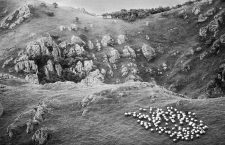 A flock of sheep grazes along the rocky, green slopes of Col d'Iraty in France's Basque Country. (Photo by julio donoso/Sygma via Getty Images)