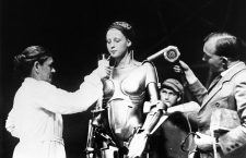 An exceptionally rare behind-the-scenes image of Brigitte Helm as the robot Maria (without her helmet) from the set of the seminal Expressionist masterpiece Metropolis (1927, Fritz Lang)  10th January 1927 - Fritz Lang's futuristic film Metropolis is released in Germany.
