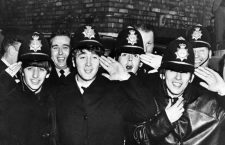 The Beatles dressed in policemens helmets as an emergency disguise to escape fans in Birmingham . 11th November 1963