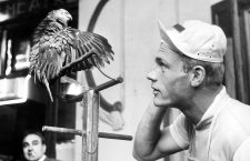 German cyclist Rudi Altig listens to a parrot on the 6th of July in 1962 at the destination of the Tour de France stage in Bayonne. | usage worldwide