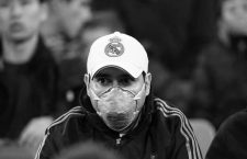 February 26, 2020, Madrid, Spain: MADRID, SPAIN - 26 FEBRUARY: A supporter of Real Madrid CF is wearing a face mask against coronavirus during the UEFA Champions League, round of 16, 1st leg football match between Real Madrid CF and Manchester City on February 26, 2020 at Santiago Bernabeu stadium in Madrid, Spain (Credit Image: © Manuel Blondeau via ZUMA Wire)
