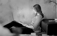Student. Woman at home with laptop